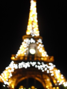 Ah, the Eiffel Tower. See how it glows in the night.