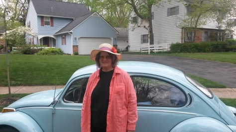 Pat Bertram with her famous blue 1972 Volkswagon.
